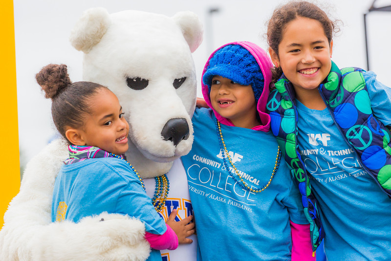 """More than 200 UAF students, staff, faculty and administrators turned out to participate in the 2013 Golden Days parade through downtown Fairbanks.  <div class=""""ss-paypal-button"""">Filename: AKA-13-3886-106.jpg</div><div class=""""ss-paypal-button-end"""" style=""""""""></div>"""