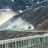 """A trucker makes his way up the north side of Atigun Pass on his drive up the Dalton Highway in mid-June.  <div class=""""ss-paypal-button"""">Filename: AKA-14-4213-154.jpg</div><div class=""""ss-paypal-button-end""""></div>"""