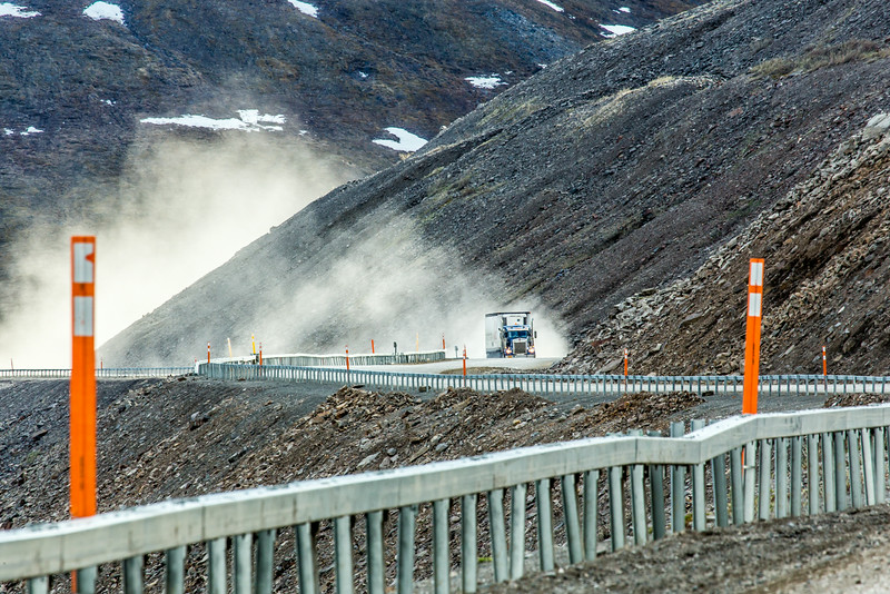 "A trucker makes his way up the north side of Atigun Pass on his drive up the Dalton Highway in mid-June.  <div class=""ss-paypal-button"">Filename: AKA-14-4213-154.jpg</div><div class=""ss-paypal-button-end""></div>"
