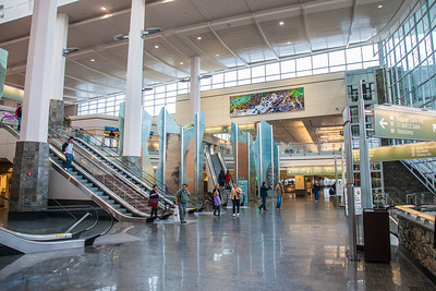 A large mural painted by UAF associate professor David Mollett hangs prominently in the Ted Stevens International Airport in Anchorage.  Filename: AKA-12-3394-17.jpg
