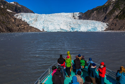 Visitors to the Kenai Fjords National Park marvel at Holgate Glacier during a cruise into the park from nearby Seward.  Filename: AKA-13-3901-67.jpg