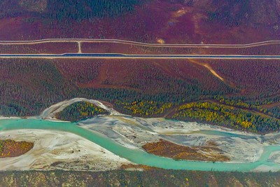The Trans-Alaska pipeline, top, runs mostly parallel to the Dalton Highway, which parallels the Dietrich River for a stretch near the southern Brooks Range.  Filename: AKA-13-3929-132.jpg