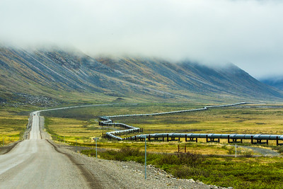 The Dalton Highway parallels the trans-Alaska pipeline as it stretches north to Alaska's arctic coast.  Filename: AKA-14-4213-149.jpg