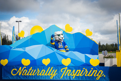 The Nook dances on board UAF's 2016 Golden Days parade float as UAF students, staff, faculty, alumni and administrators participate in representing the university.  Filename: AKA-16-4939-83.jpg