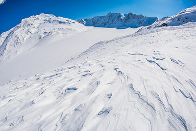 Wind blown patterns in the snow near the Jarvis Glacier in the eastern Alaska Range.  Filename: AKA-13-3795-144.jpg