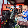 "Wearing an Alaska Nanooks shirt, Trenton Reabold is all smiles at the driver's seat of a UAF Fire Department fire truck during UAF Day at the Tanana Valley State Fair.  <div class=""ss-paypal-button"">Filename: AKA-13-3900-63.jpg</div><div class=""ss-paypal-button-end"" style=""""></div>"