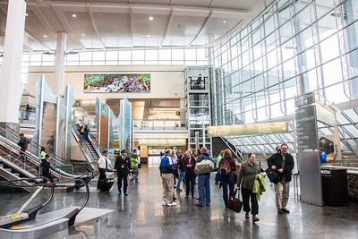 A large mural painted by UAF associate professor David Mollett hangs prominently in the Ted Stevens International Airport in Anchorage.  Filename: AKA-12-3394-11.jpg