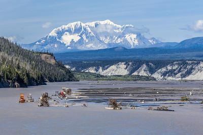 16,380-foot Mt. Blackburn looms over fishwheels along the Copper River in early August.  Filename: AKA-13-3901-28.jpg