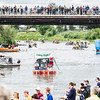 "And they're off! Participants of the 2013 Red Green Regatta push off from the shore and float down river.  <div class=""ss-paypal-button"">Filename: AKA-13-3885-76.jpg</div><div class=""ss-paypal-button-end"" style=""""></div>"