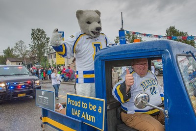 Bear and the Nanook near the finish line in the rain during the 2012 Golden Days parade.  Filename: AKA-12-3472-51.jpg