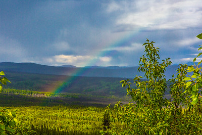 A rainbow appears over the forest along the Elliot Highway, about 50 miles north of Fairbanks.  Filename: AKA-14-4213-239.jpg