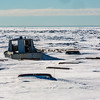 "Old boats and vehicles lie under the snow along the Seward Peninsula coast near Nome, site of UAF's Northwest Campus.  <div class=""ss-paypal-button"">Filename: AKA-16-4865-122.jpg</div><div class=""ss-paypal-button-end""></div>"
