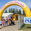 "A group of people enter the Tanana Valley State Fair during UAF Day.  <div class=""ss-paypal-button"">Filename: AKA-13-3900-9.jpg</div><div class=""ss-paypal-button-end"" style=""""></div>"