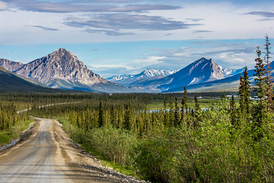 Peaks of the southern Brooks Range highlight the scenery along this stretch of the Dalton Highway, about 250 miles north of Fairbanks.  Filename: AKA-14-4213-168.jpg