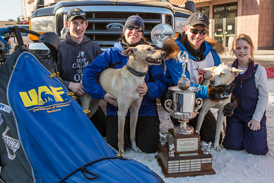 Associate Professor and Associate Dean of Veterinary Medicine Arleigh Reynolds pauses for a portrait with his family after winning the first place of the 2014 Open North American Sled Dog Race in downtown Fairbanks.  Filename: AKA-14-4120-120.jpg
