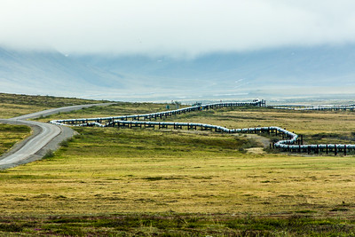 The Dalton Highway parallels the trans-Alaska pipeline as it stretches north to Alaska's arctic coast.  Filename: AKA-14-4213-146.jpg