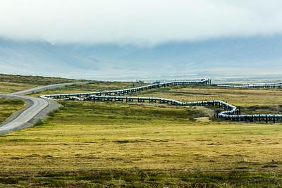 The Dalton Highway parallels the trans-Alaska pipeline as it stretches north to Alaska's arctic coast.  Filename: AKA-14-4213-146.jpg