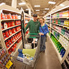 "George Keeney and Tristen Larson stock up on items during Fred Meyer's Midnight Extravaganza Wednesday morning, August 29, 2012.  <div class=""ss-paypal-button"">Filename: AKA-12-3520-15.jpg</div><div class=""ss-paypal-button-end"" style=""""></div>"