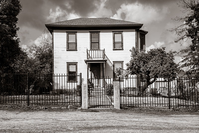 A sepia color image of a spooky house.