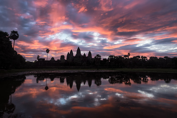 Photograph: Sunrise At Angkor Wat - Beautiful sunrise over Angkor Wat temple in Siem Reap, Cambodia.