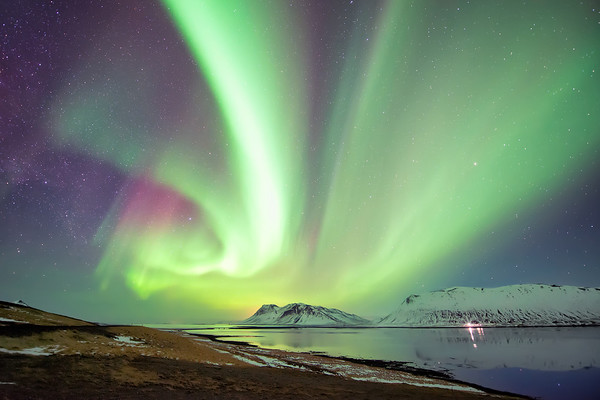 Photograph: Colours of the Night Sky - The aurora borealis at a fjord in the Snæfellsnes Peninsula, West Iceland.