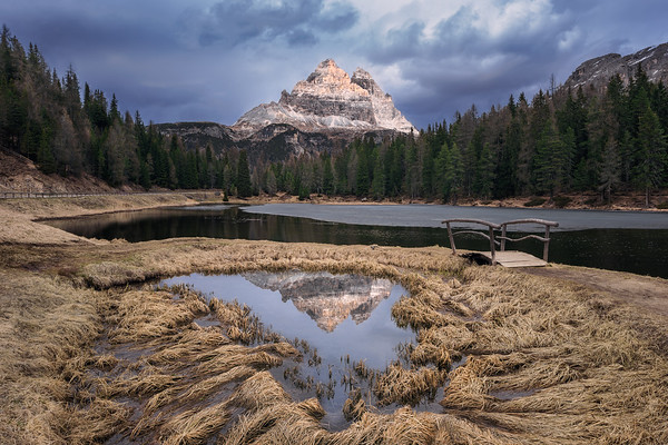 Photograph: Lago d'Antorno - Tre Cime di Lavaredo reflected in some still water in Lago d'Antorno in the Dolomites, Italy.