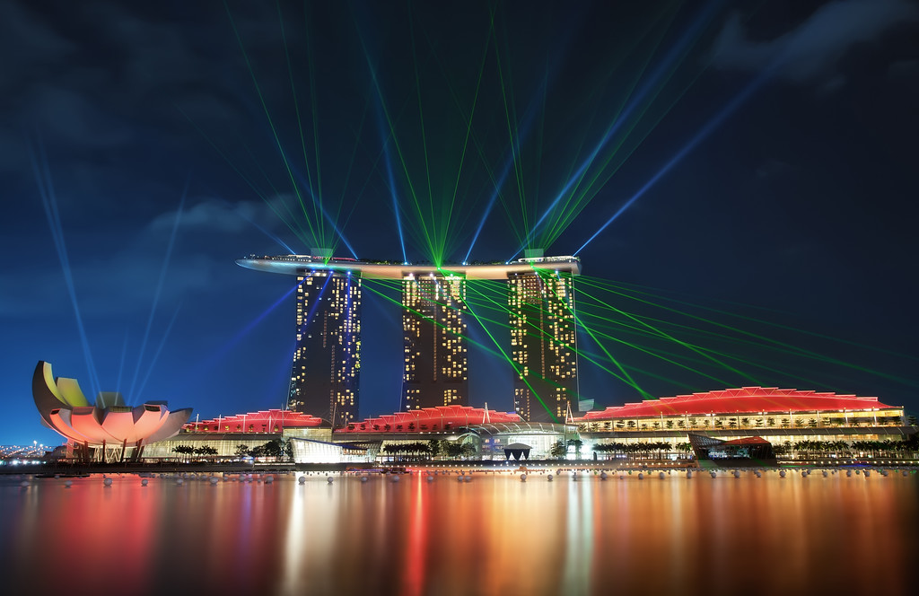 Photograph: Marina Bay Sands - Blue hour, manually blended, increased dynamic range photograph of the laser show at the Marina Bay Sands hotel and resort in Singapore.