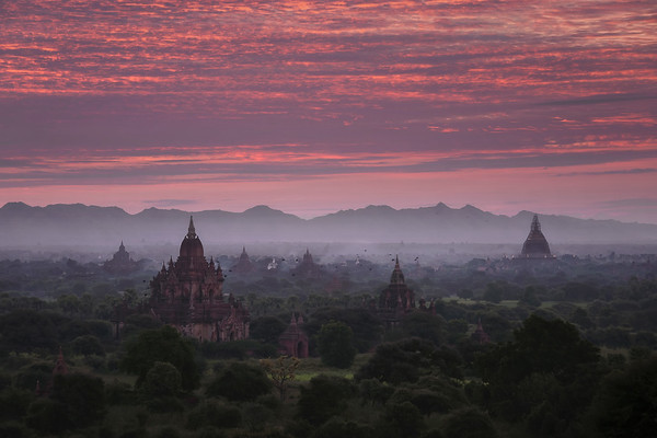 Photograph: Bagan Birds - Sunrise over Bagan from the Shwesandaw Pagoda, with Dhammayan Gyi Temple in the foreground and Dhammayazaka Pagoda in the distance.
