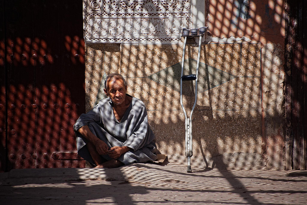 Photograph: Shade - A weary man rests under the shade in Marrakech, Morocco.