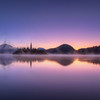 Serene sunrise at Lake Bled, Slovenia.