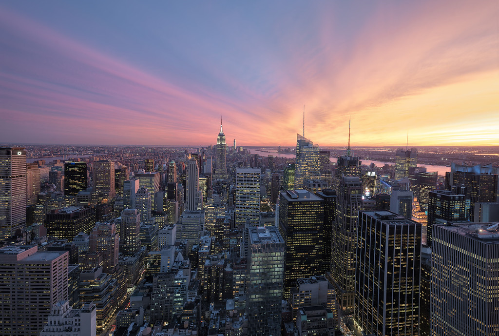 Photograph: Top of The Rock - View of New York's downtown Mahattan from the top of the Rockafeller Center.