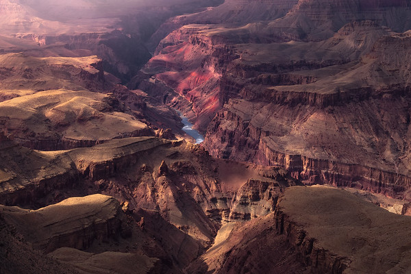 Photograph: Chasm - Dappled light over the Colorado River and Grand Canyon in Arizona, USA.