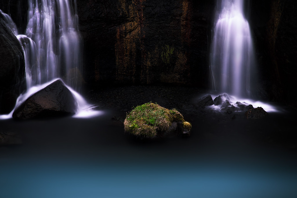 Photograph: Melon Bear Rock - Mossy rock underneath some waterfall at Hraunfoss in Iceland.