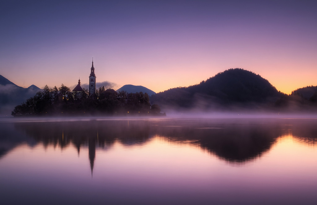Photograph: Dawn at Lake Bled - HDR photo of sunrise over Bled Island in Slovenia.