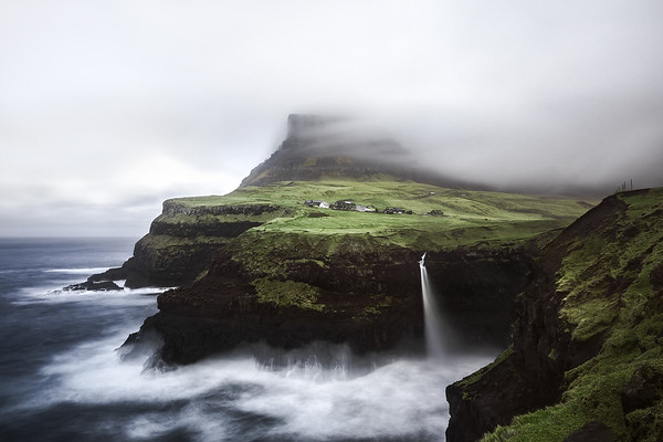 Photograph: Crashing Waves - Waves crash onto the rocks by Múlafossur Waterfall in Gásadalur, Faroe Islands.