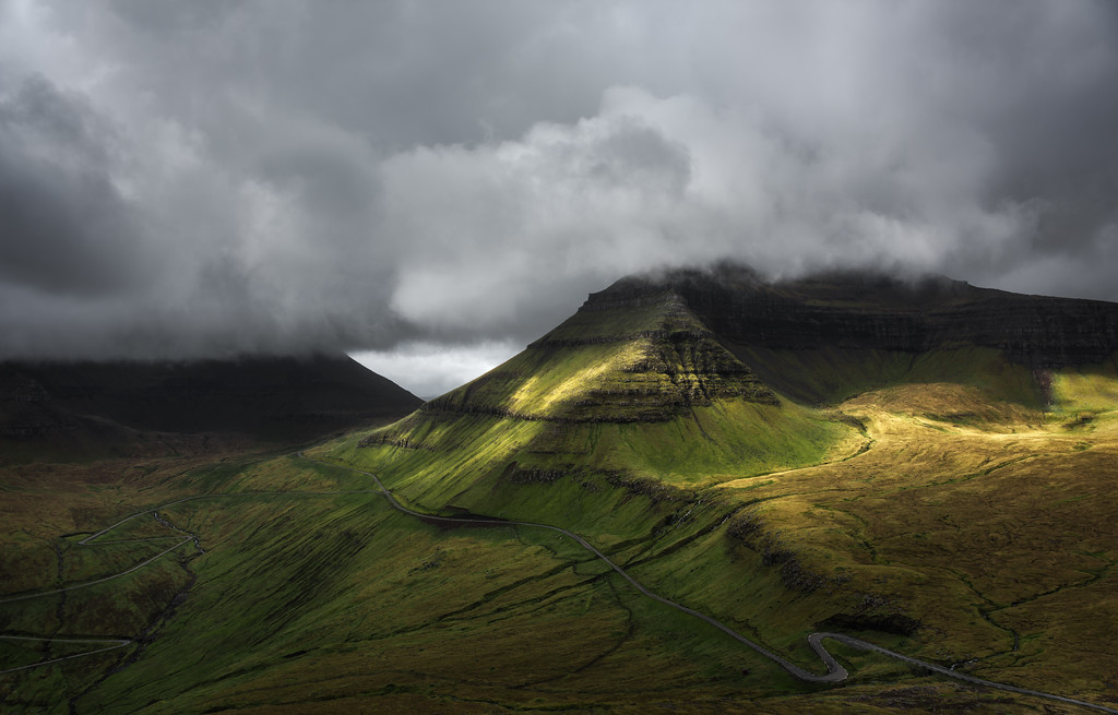 Photograph: After The Storm - Light on the mountains in the Faroe Islands just after a heavy storm.