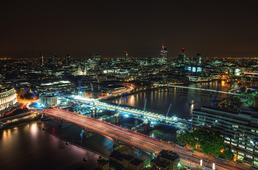 Photograph: Luminous London - St Paul's and the City of London lit up at night.
