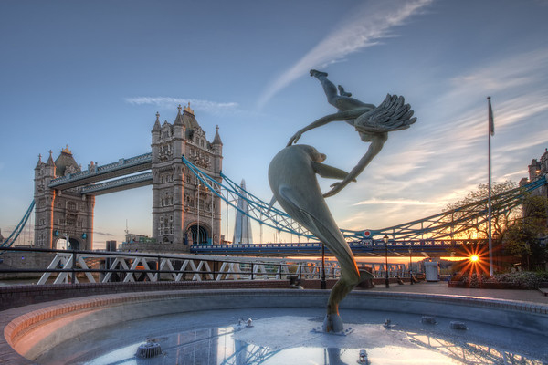 Photograph: Girl with a Dolphin - Sunset at David Wynne's Girl with a Dolphin fountain statue near Tower Bridge in London, England.
