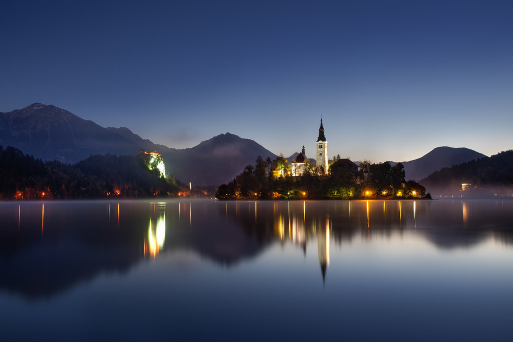 Photograph: The Still Lake - Night shot of Bled Island on Lake Bled in Slovenia, just before sunrise.