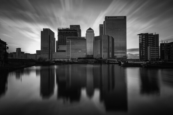 Photograph: Dark Financial Skies - Monochrome, long Exposure sunset over Canary Wharf as seen from Poplar Dock.