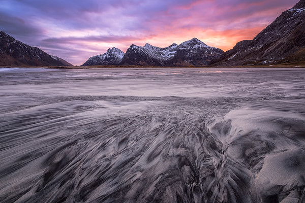 Photograph: From The Mountains To The Sand - Sunrise at Ramberg beach in the arctic regeion of Lofoten, Norway.