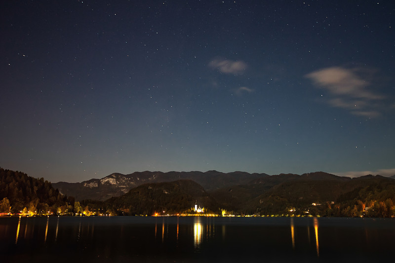 A stary sky above Lake Bled and the Julian Alps in Slovenia.