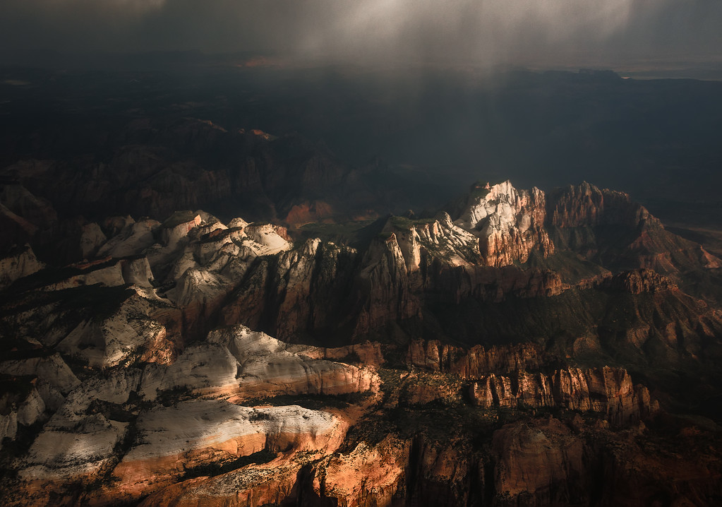 Photograph: Zion - Sunlight and rain simultaneously hit the Alter of Sacrifice and West Temple mountains of Zion National Park in Utah, USA.