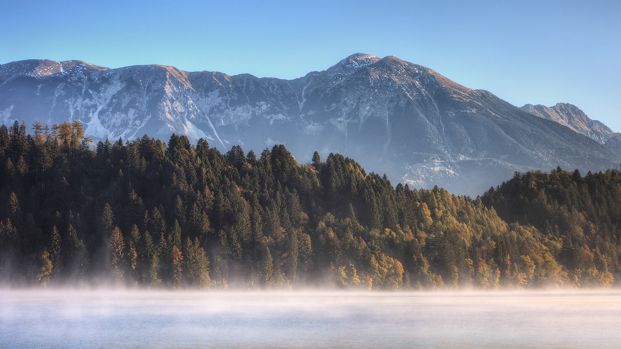 The morning sun hitting the Julian Alps at Lake Bled in Slovenia.