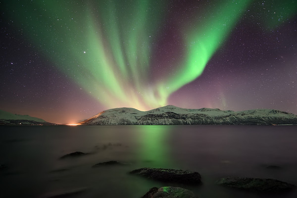Photograph: Lights of Lyngen - The Northern Lights reflected in Ullsfjorden near Tromsø in northern Norway.
