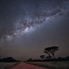The Milky Way over a dusty african road in Nambia.