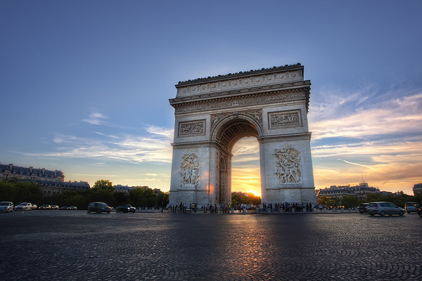 Photograph: Arc de Triomphe - Sunset over the Arc de Triomphe in Paris, France.