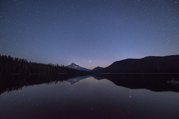 Photograph: The Lost Lake - A moody night scene above Lost Lake and Mount Hood in Oregon, USA.