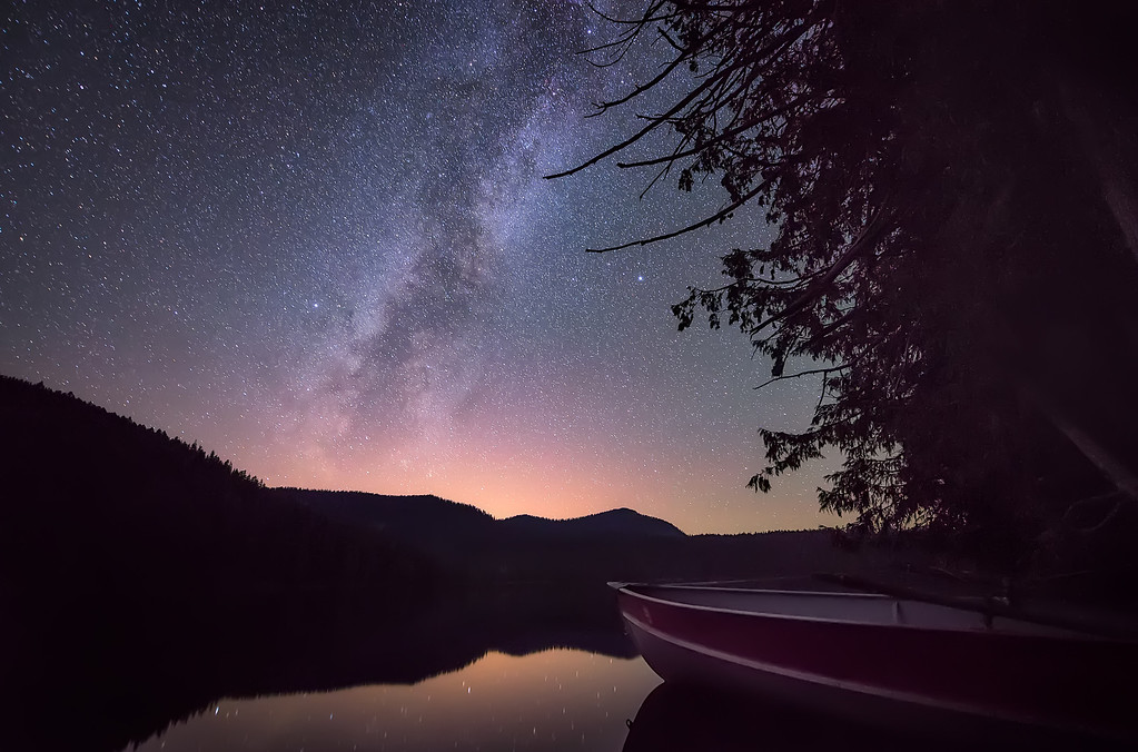 Photograph: Vessel To The Stars - A moored boat afloat in the Lost Lake, Oregon.
