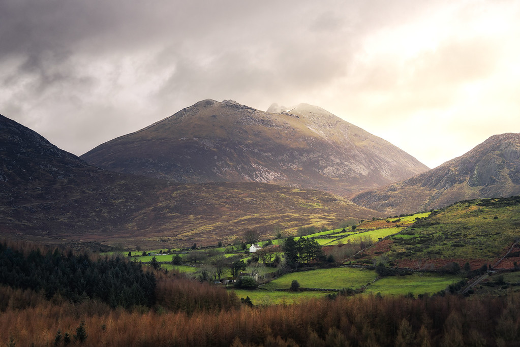 Photograph: Slieve Bearnagh - A low sun shines through the clouds surrounding Slieve Bearnagh in the Mourne Mountains, Northern Ireland.